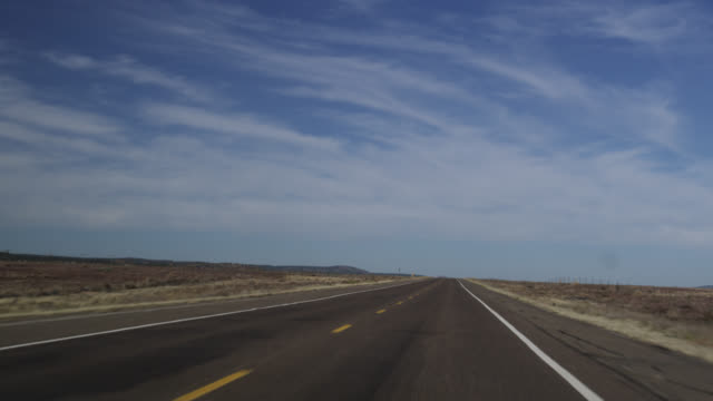vidéos et rushes de ms ts view of route sixty six passing through seligman towards flagstaff / route 66, arizona, usa   - route 66