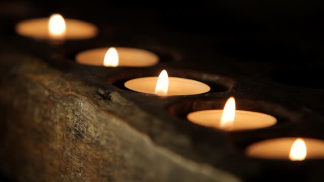 cu view of  row of flickering candles / singapore - five objects stock videos & royalty-free footage