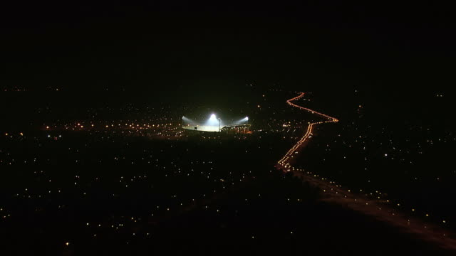 WS AERIAL View of Royal Bafokeng Stadium and surrounding areas at night / Rustenburg, North West Province, South Africa