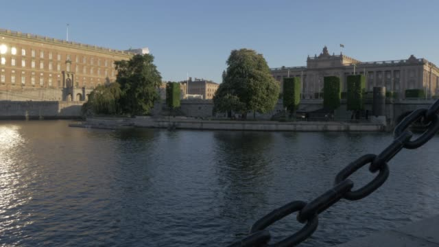 view of royal palace at sunset, gamla stan, stockholm, sweden, scandinavia, europe - palacio stock videos & royalty-free footage