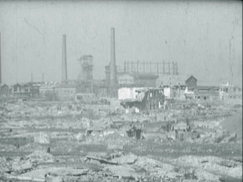 view of rubble from factories / people scavenging among the debris / little boy playing with a toy tank - ruhr stock videos & royalty-free footage