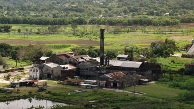 ws zo aerial pov view of ruined central coloso sugar cane refinery / aguada, puerto rico, united states  - 工場の煙突点の映像素材/bロール