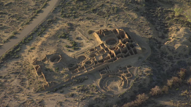ws aerial zo view of ruins and pull back at chaco canyon national historical park / new mexico, united states - chaco culture national historical park stock videos & royalty-free footage