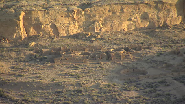 WS AERIAL View of ruins at Chaco Canyon National Historical Park in early morning light / New Mexico, United States
