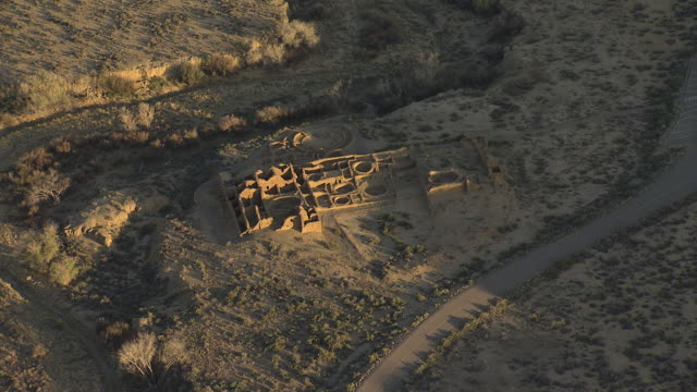 WS AERIAL ZI View of ruins Chaco Canyon National Historical Park under big open sky / New Mexico, United States