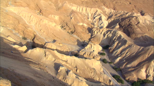 aerial ds ts ws  view of ruins of metzad zohar ancient stronghold aerial with canyon / sourn judea desert, israel - old ruin stock videos & royalty-free footage