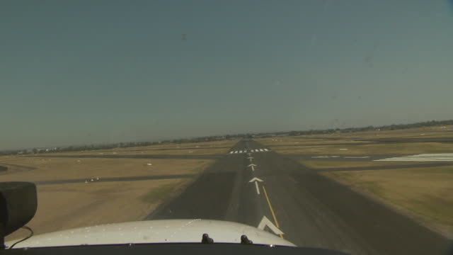 view of runway from plane landing, australia - holprig stock-videos und b-roll-filmmaterial