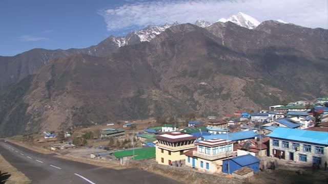 ws pan view of runway of lukla airport at lukla (khumbu valley) / lukla, khumbu region, nepal - khumbu stock videos and b-roll footage