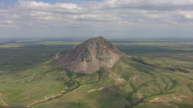 WS AERIAL TU View of rural area to reveal Bear Butte in Meade County / South Dakota, United States
