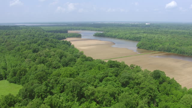 WS AERIAL POV View of rural landscape with river / Mississippi, United States