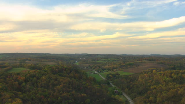 stockvideo's en b-roll-footage met ws aerial view of rural landscape with road and clouds in sky in washington county / pennsylvania, united states - pennsylvania