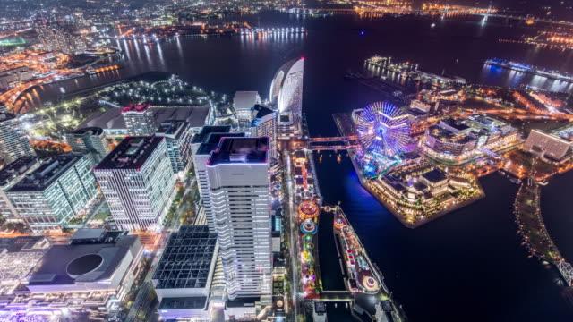 t/l ws ha view of rush hour traffic and modern buildings in yokohama at night. - yokohama stock videos and b-roll footage