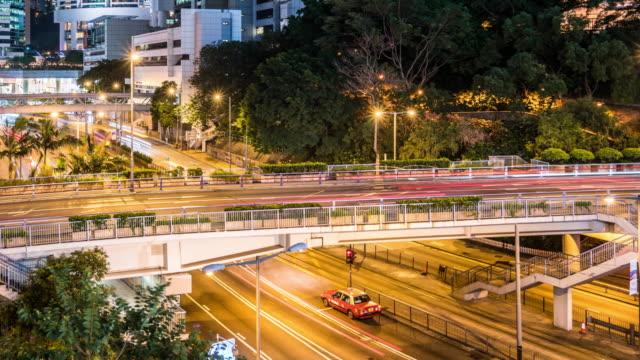 T/L WS PAN View of Rush Hour Traffic at Night / Hong Kong, China