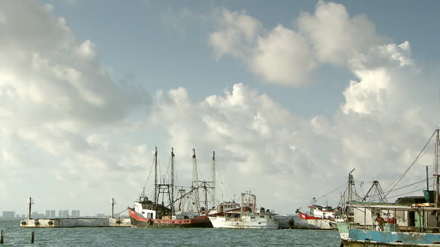 ws view of rusty fishing boats on shore of isla mujeres, shoreline of cancun / isla mujeres, quintana roo, mexico - quintana roo stock videos and b-roll footage