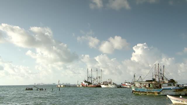 WS View of Rusty fishing boats on shore of Isla Mujeres, shoreline of Cancun / Isla Mujeres, Quintana Roo, Mexico