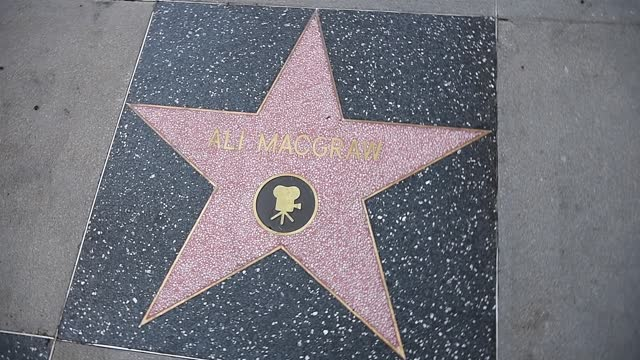 view of ryan o'neal and ali macgraw's stars next to farrah fawcett's on the hollywood walk of fame on february 12, 2021 in hollywood, california. the... - ali macgraw stock-videos und b-roll-filmmaterial