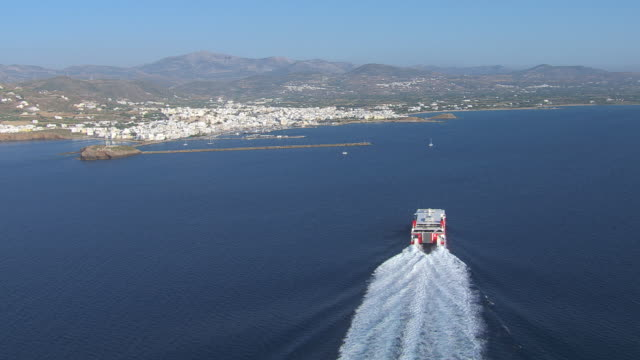 WS AERIAL View of sailboat and coastline with city of naxos / Naxos, Cyclades, Greece