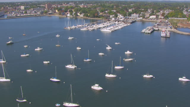 ws aerial pov view of sailboats anchored in salem harbour in brewer hawthorne cove marina / salem, massachusetts, united states - salem stock videos & royalty-free footage