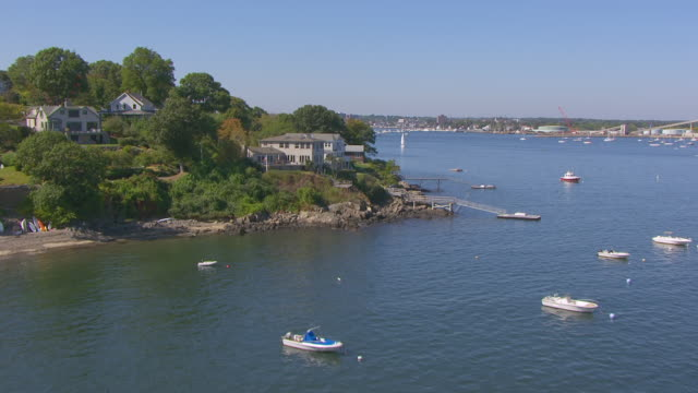 ws aerial pov view of sailboats anchored in salem harbour with background in homes / marblehead, massachusetts, united states - salem massachusetts stock videos & royalty-free footage