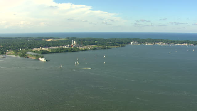 ws aerial view of sailboats on muskegon lake with lake michigan in distance / muskegon, michigan, united states - michigan stock videos and b-roll footage