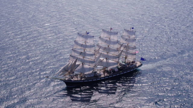 view of sailing ship on sea near haeundae beach (famous beach in south korea) in busan - nave a vela video stock e b–roll