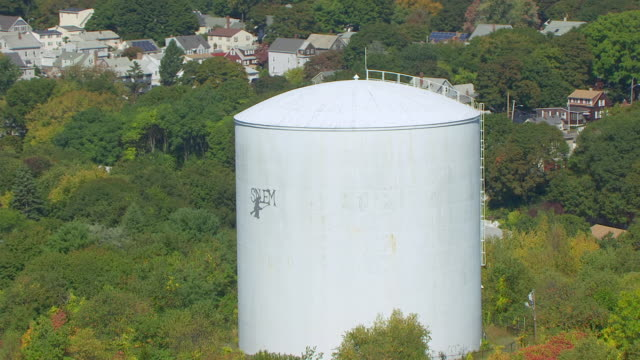 ms aerial pov zo view of 'salem' logo in water stage tower at gallows hill park / salem, massachusetts, united states - salem stock videos & royalty-free footage