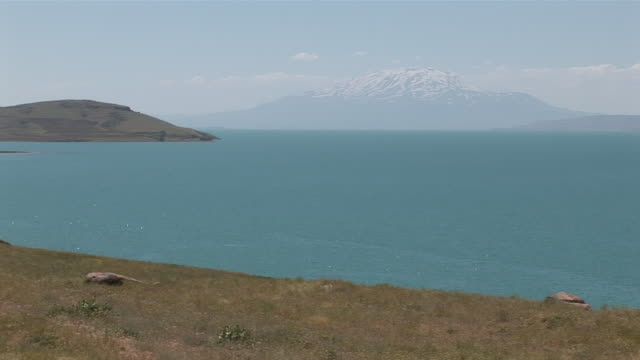 ws view of saline lake and mountain with snow in rear / lake van, van district, turkey - lake van stock videos and b-roll footage