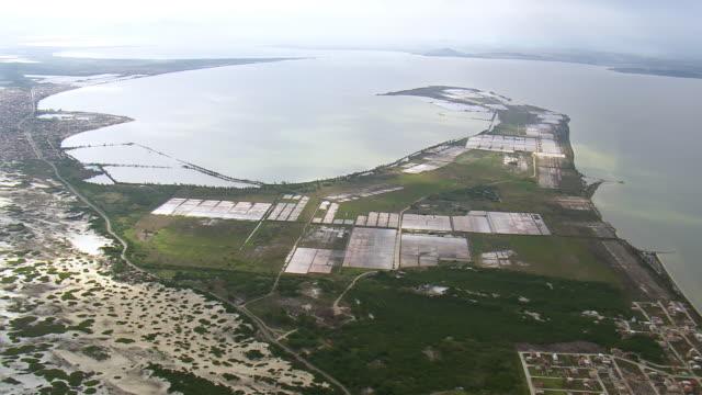 ws aerial view of salt farm near ocean / rio de janeiro, brazil - mining点の映像素材/bロール