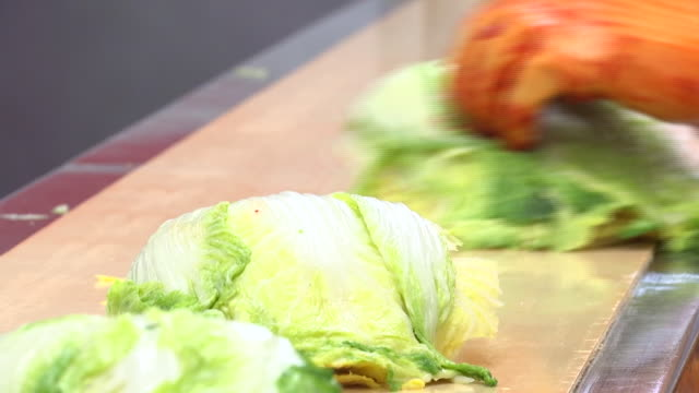 view of salted cabbage passing on a conveyor belt  (kimchi is popular traditional fermented korean side dish) - fermenting stock videos and b-roll footage