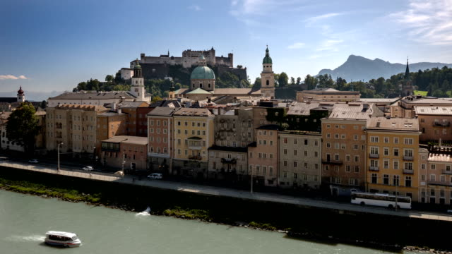 view of salzburg old town across the salzach river - campo totale video stock e b–roll