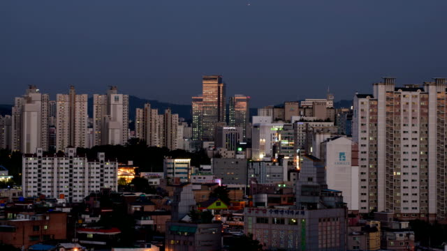 view of samsung digital city (office building) and residential district at sunset - suwon stock videos and b-roll footage