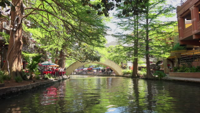 view of san antonio river walk from a boat - san antonio texas stock videos and b-roll footage