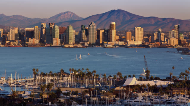 T/L View of San Diego skyline with marina in foreground at sunset / San Diego, California, USA