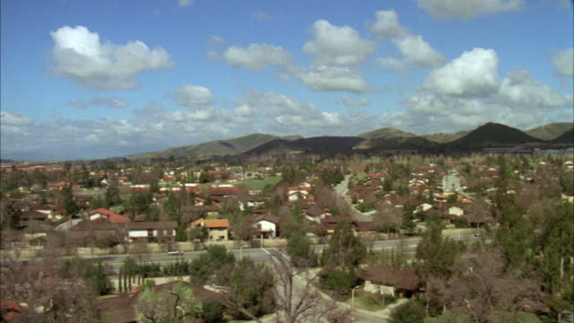 WS PAN View of  san fernando valley, woodland hills at fluffy clouds