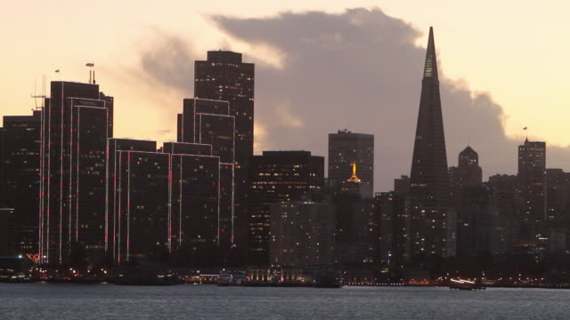 ms view of  san francisco evning skyline from treasure island with dramatic clouds / san francisco, california - real time stock videos & royalty-free footage
