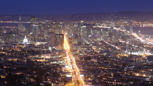 T/L WS  View of San Francisco with Bay Bridge, dusk to night / California, USA