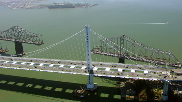 WS ZI AERIAL POV View of San Francisco-Oakland Bay Bridge with Yerba Buena Island / San Francisco, California, United States