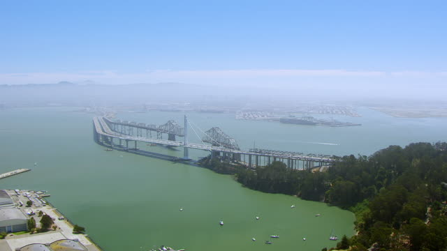 WS AERIAL POV View of San Francisco-Oakland Bay Bridge with Yerba Buena Island / San Francisco, California, United States