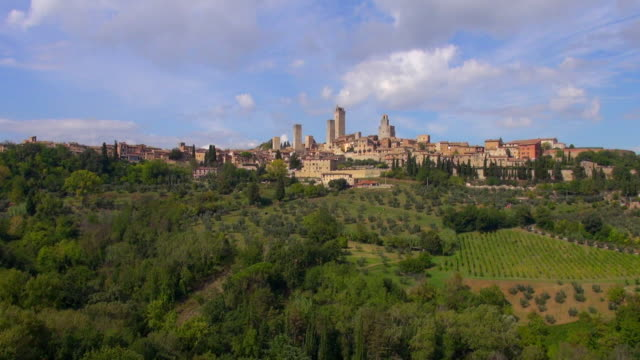 WS AERIAL PAN View of San Gimignano towers and olive trees / San Gimignano, Tuscany, Italy
