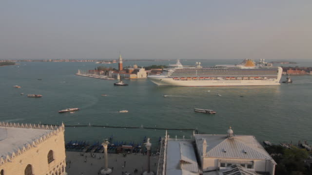 ws view of san giorgio maggiore and cruise ship passing by / venice, veneto, italy - kreuzfahrtschiff stock-videos und b-roll-filmmaterial