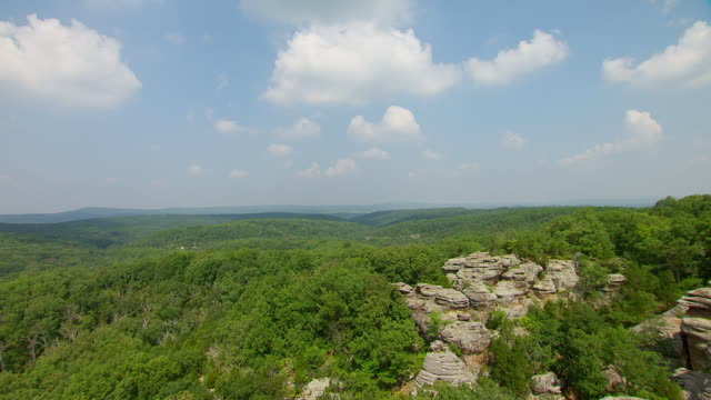 WS AERIAL POV View of sandstone rock formations and cliffs with forest area at Garden of the Gods Wilderness / Saline County, Illinois, United States