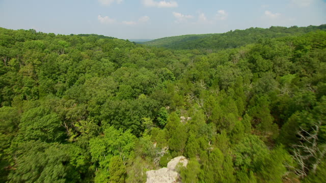 WS AERIAL POV View of sandstone rock formations and valley with forest area at Garden of the Gods Wilderness / Saline County, Illinois, United States