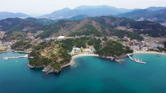 view of sangjokam county park coast sea and dinosaur museum in south gyeongsang province south korea - extinct stock videos & royalty-free footage
