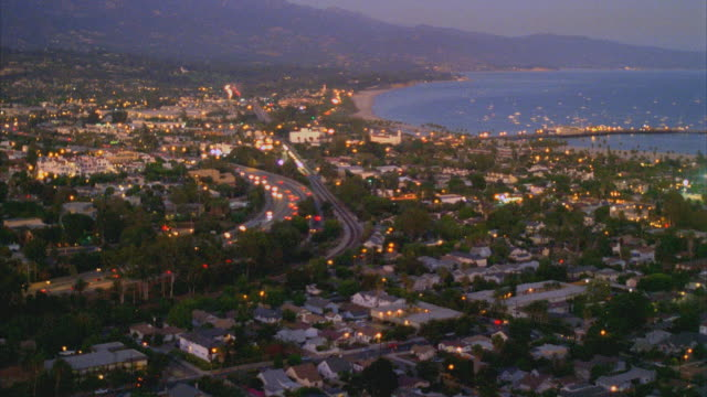 ws ha pan view of  santa barbara coastline at dusk / california, usa - santa barbara california stock videos & royalty-free footage