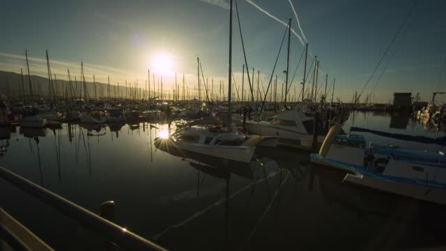 ws pan view of santa barbara yacht harbor at sunset - santa barbara california stock videos and b-roll footage