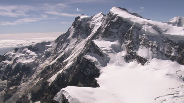 ws aerial view of santa caterina ridge above monte rosa east face towards nordend / nordend, valais, switzerland - pennines stock videos & royalty-free footage