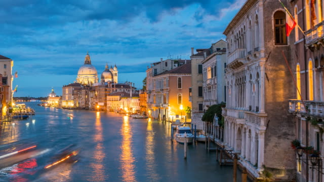 view of santa maria della salute in venice at night - grand canal venice stock videos & royalty-free footage