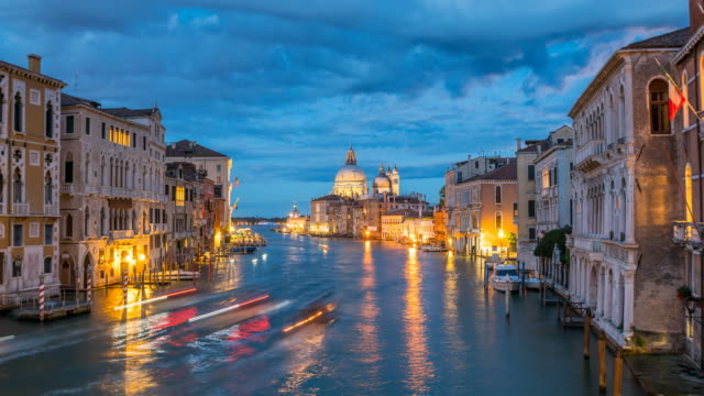 view of santa maria della salute in venice at night - venice italy stock videos & royalty-free footage
