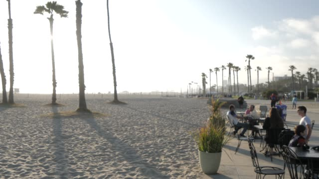 view of santa monica beach cafe and beach, santa monica, los angeles, california, united states of america, north america - santa monica beach stock videos & royalty-free footage