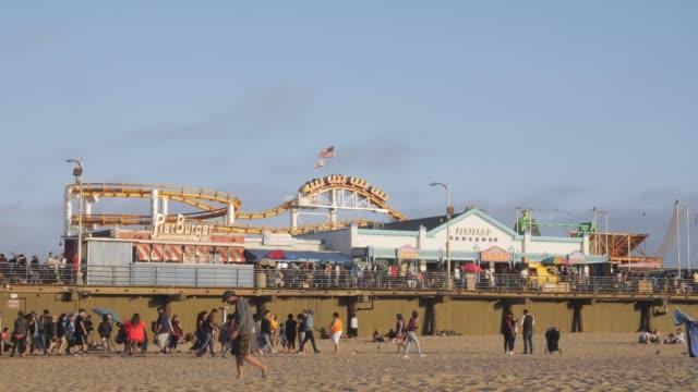view of santa monica pier and beach, santa monica, los angeles, la, california, united states of america, north america - volksfest stock-videos und b-roll-filmmaterial